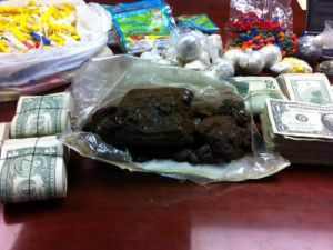 n this 2011 photo, results of a Regional Street Enforcement Team and U.S. Drug Enforcement Agency raid show 3 pounds of heroin, 3 ounces of cocaine and $10,639 in cash. (Photo: RGJ file photo )