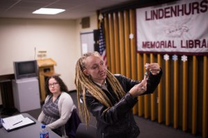 Tina Wolf demonstrates the use of naloxone to community members in Lindenhurst, N.Y., during an overdose prevention training. Georgia Dolan-Reilly (left) of the Suffolk County Prevention Resource Center helped with the training. Kevin Hagen for NPR